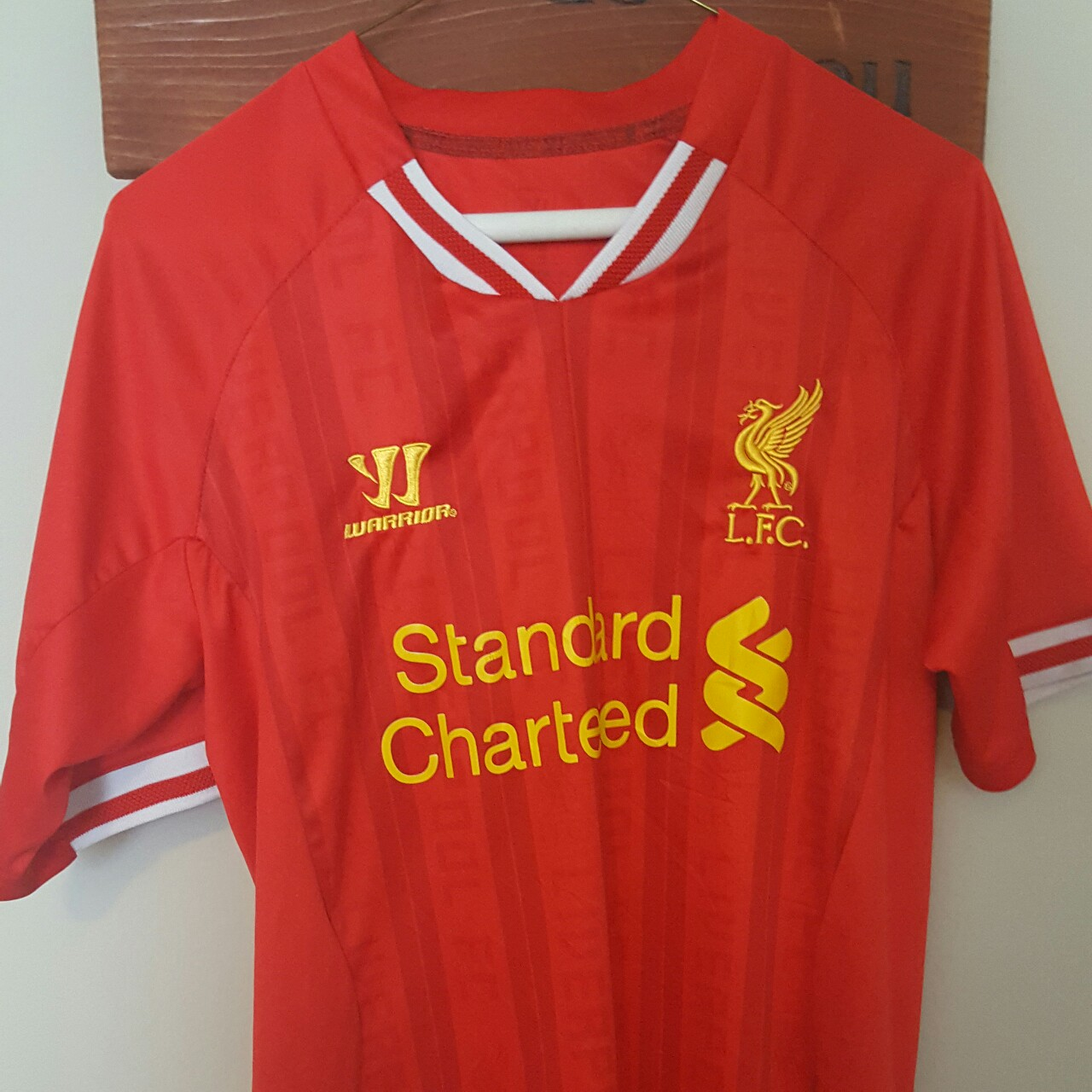 sports shoes cacfc f5f98 Warrior Liverpool Standard Chartered Jersey Size... - Depop