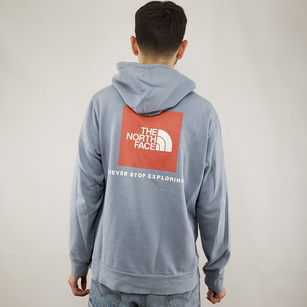 0d657c3a0 The North Face Hoodie light blue/red with print on... - Depop
