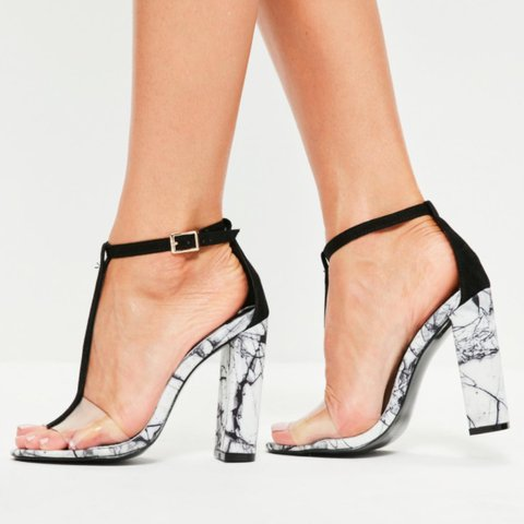 66c7ca60483  abi hill. 2 years ago. United Kingdom. Missguided marble print clear strap  heels. Worn once. Size 5.