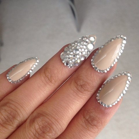 Gorgeous nude stiletto nails with gems around the edges and - Depop