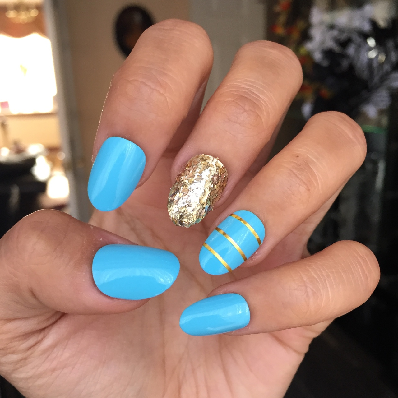 Gorgeous baby blue short almond nails with gold , Depop