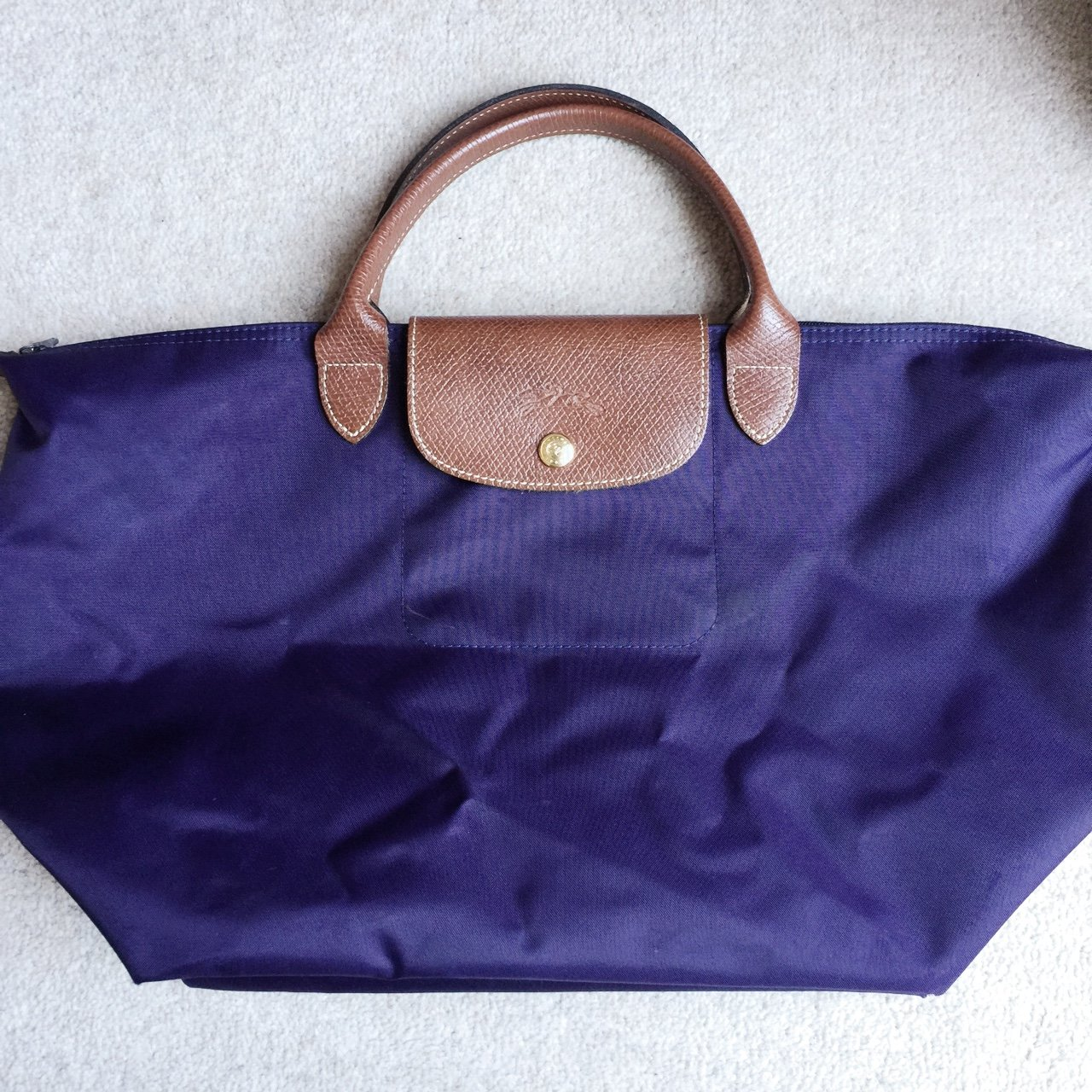 905d51e1d8f55  hcanderson. 3 years ago. United Kingdom. Real  longchamp purple bag.