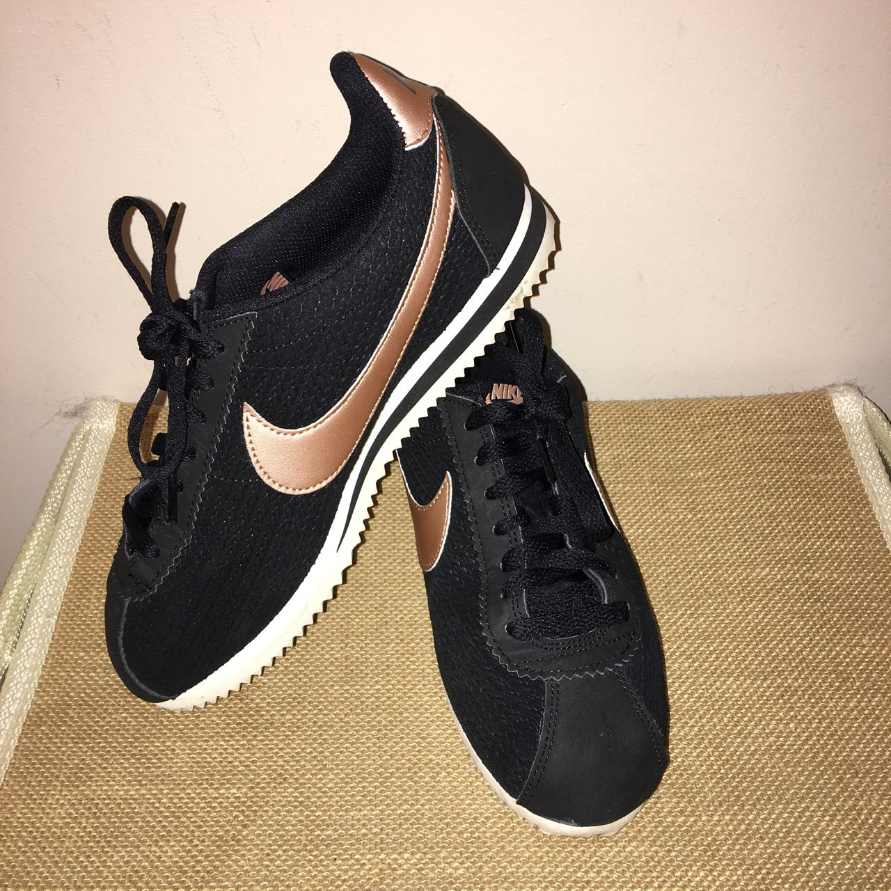official photos 22063 6217c @hkeach. 2 years ago. Newhall, United Kingdom. Nike Cortez, black and rose  gold.