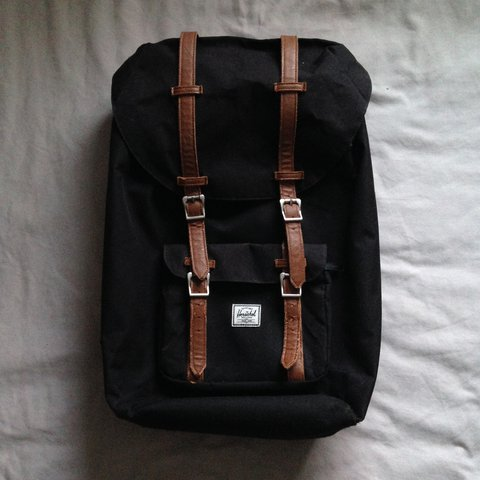 a4e09b2a06f Herschel Little America Backpack - Black. Large pouch inside - Depop