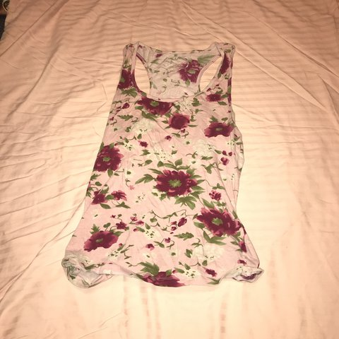 c02252fae4e 2 Rue 21 tank tops Light pink floral tank and a black and a - Depop