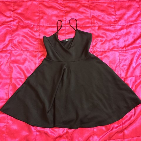 297689e2a7 Black bodycon skater dress with plunge neckline from Never - Depop