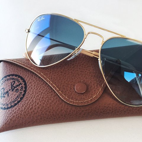 90dcb897bc58d Ray-Ban 3025 Aviators in gold frames and blue gradient Size - Depop