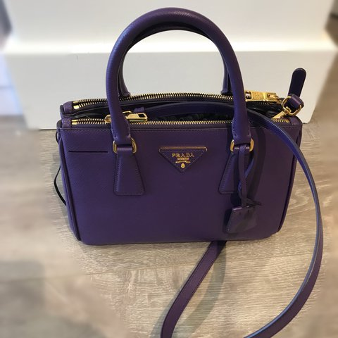 2429c2e9cd62 @luxconsign. 2 years ago. New York, NY, USA. NEW IN! 100% AUTHENTIC Prada  Saffiano Lux Double Zip Purple Leather ...