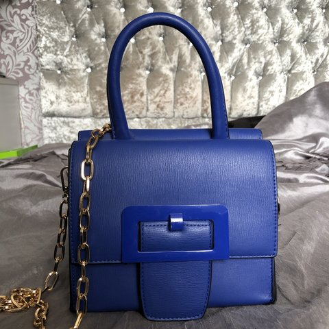94fc3ded4 @aw001. last month. Glasgow, United Kingdom. Royal blue tote cross body bag.  Gold chains ...