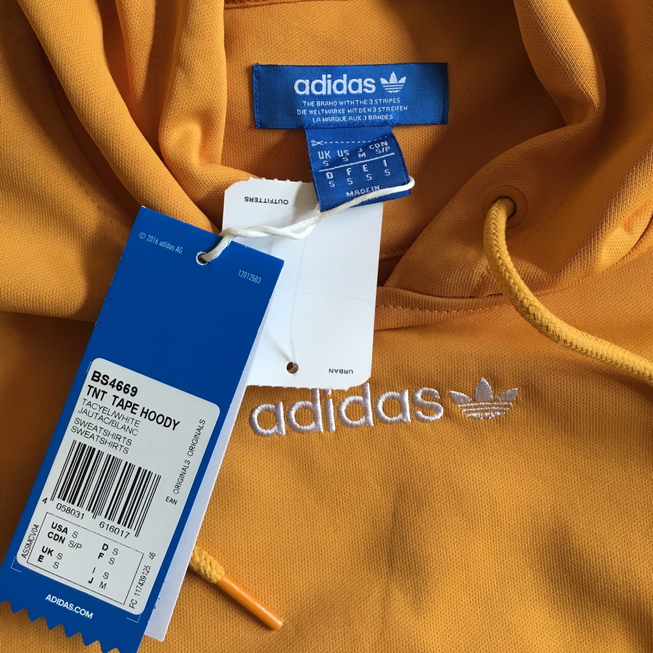 Adidas TNT tape hoodie colour yellow from urban Depop