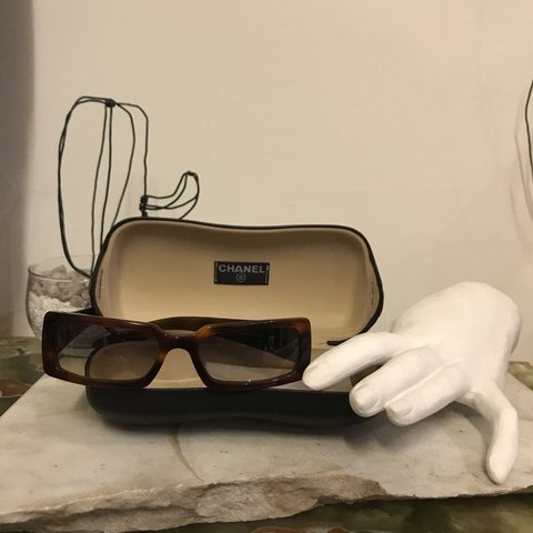 28525656b5b0 @_constance_. 4 months ago. Cosenza, Italia. Chanel vintage quilted brown arms  sunglasses ...