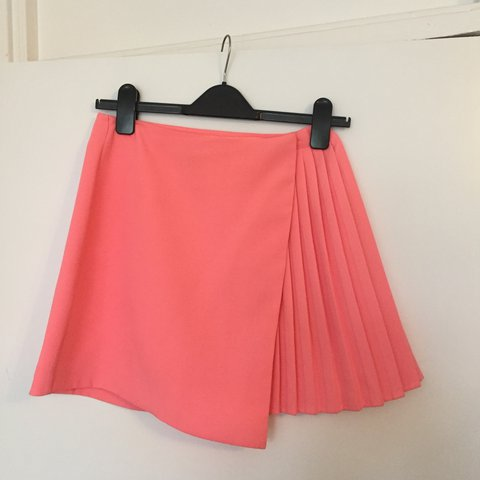 ed6bfba52 @katie_egerton. 2 years ago. London, United Kingdom. Bright pink/coral  pleated skirt . PE/cheerleader style wrap ...