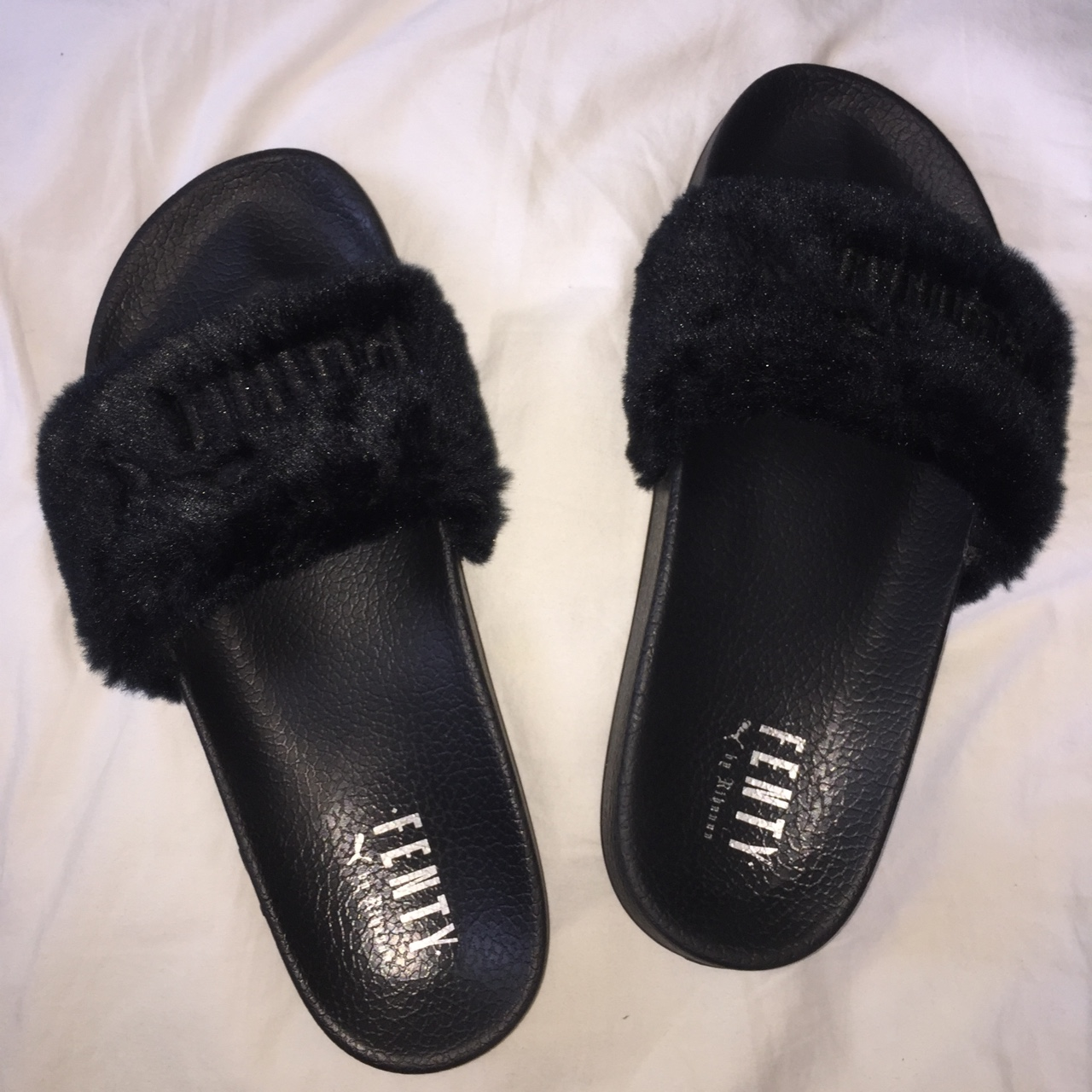 cheap for discount ad8f3 f3487 Fenty x Puma by Rihanna Faux fur slides in black.... - Depop