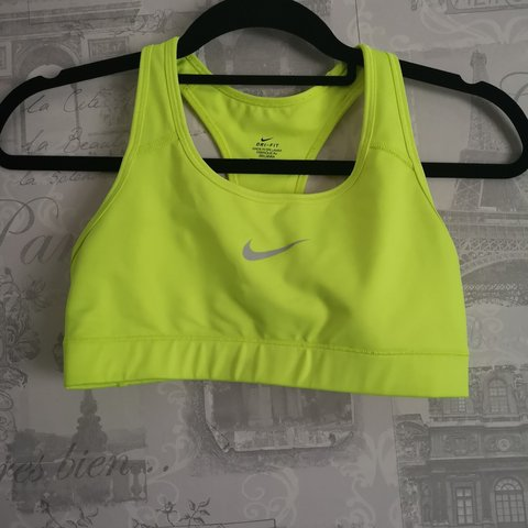 8c0a10cc12072 Like new Nike sports bra. Size small. Bright yellow in - Depop