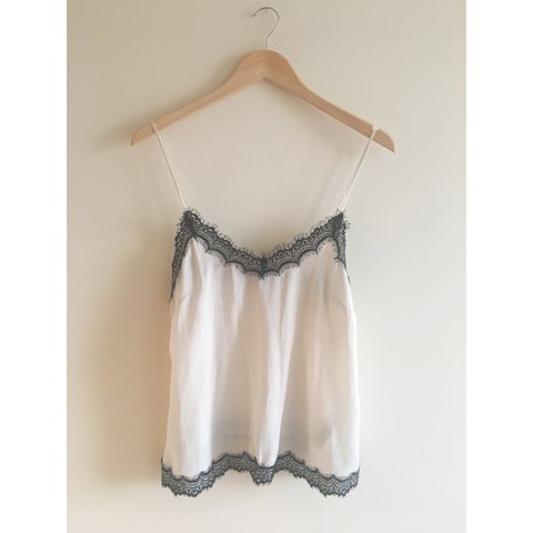 38d7a3fb76 New Look Petite cream cami with black eyelash lace trim and - Depop