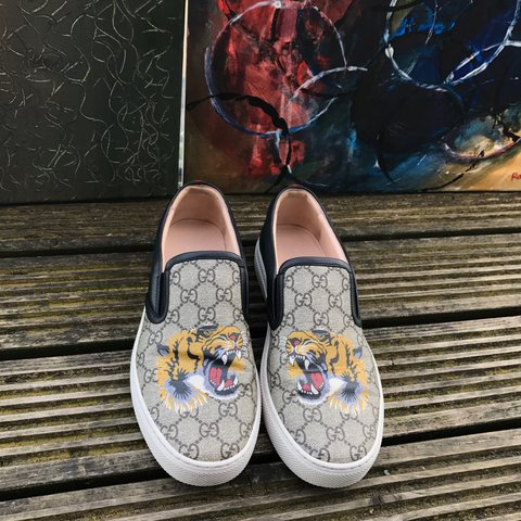 ffc993bf966 Item  GUCCI GG Supreme canvas slip ons with tiger print