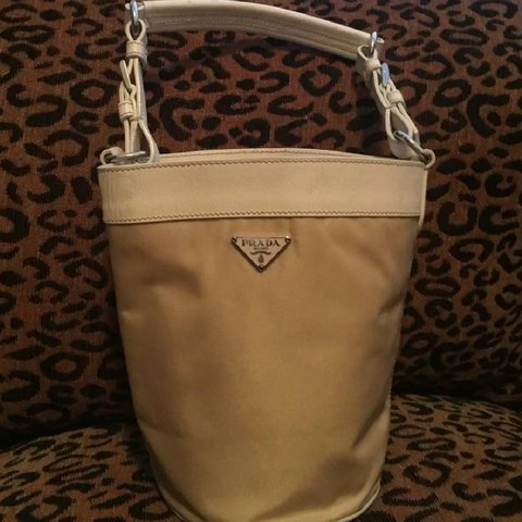 97822ee61d5c @bootsieboo. last year. Waxahachie, Ellis County, United States. Prada  white leather trimmed canvas mini bucket bag.