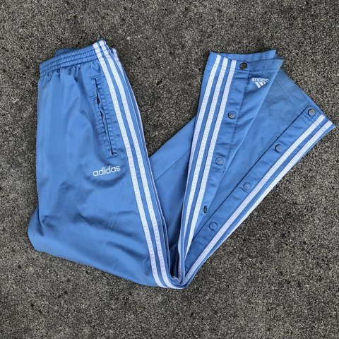 Baby blue 90's adidas tear away track pants. </p>                     </div> 		  <!--bof Product URL --> 										<!--eof Product URL --> 					<!--bof Quantity Discounts table --> 											<!--eof Quantity Discounts table --> 				</div> 				                       			</dd> 						<dt class=