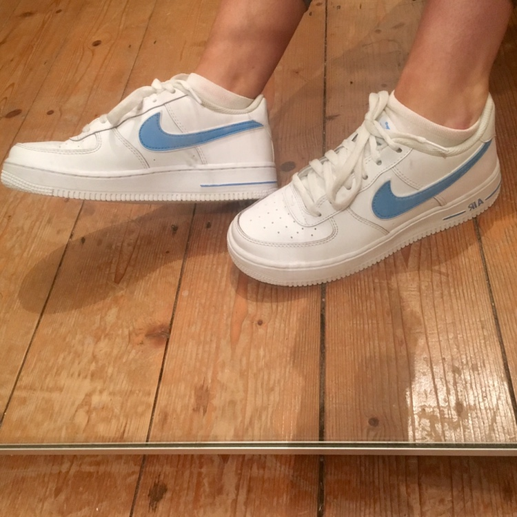 Nike air force ones with a blue tick