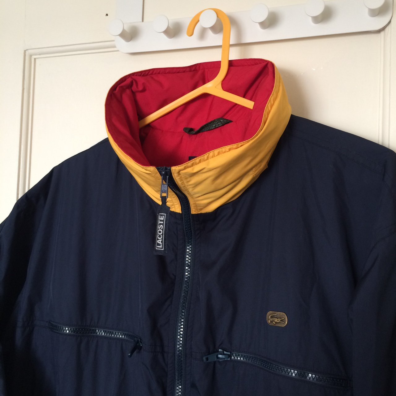 f0af872fbcc2 LACOSTE lined windbreaker jacket coat. Navy   red   yellow. - Depop