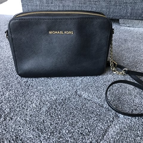772a84227bbe @emilyhill2405. 5 days ago. Manningtree, United Kingdom. Michael Kors bag, small  black cross body with gold hardware.