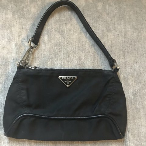 ab1ff7725f5f @arkxstyl3. 3 months ago. Sheffield, United Kingdom. Prada mini bag it's  the black tessuto nylon and saffiano pochette purse, perfect size ...