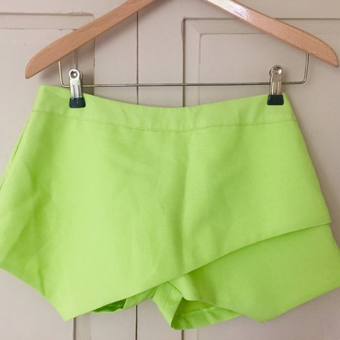 adc7581697 @ella_harvey7. 2 years ago. Chudleigh, United Kingdom. Neon green/yellow  skort (skirt/shorts) from boohoo.