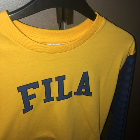 7affde3b Yellow Fila 3/4 sleeve top. Would fit an 8-10. Never worn - Depop