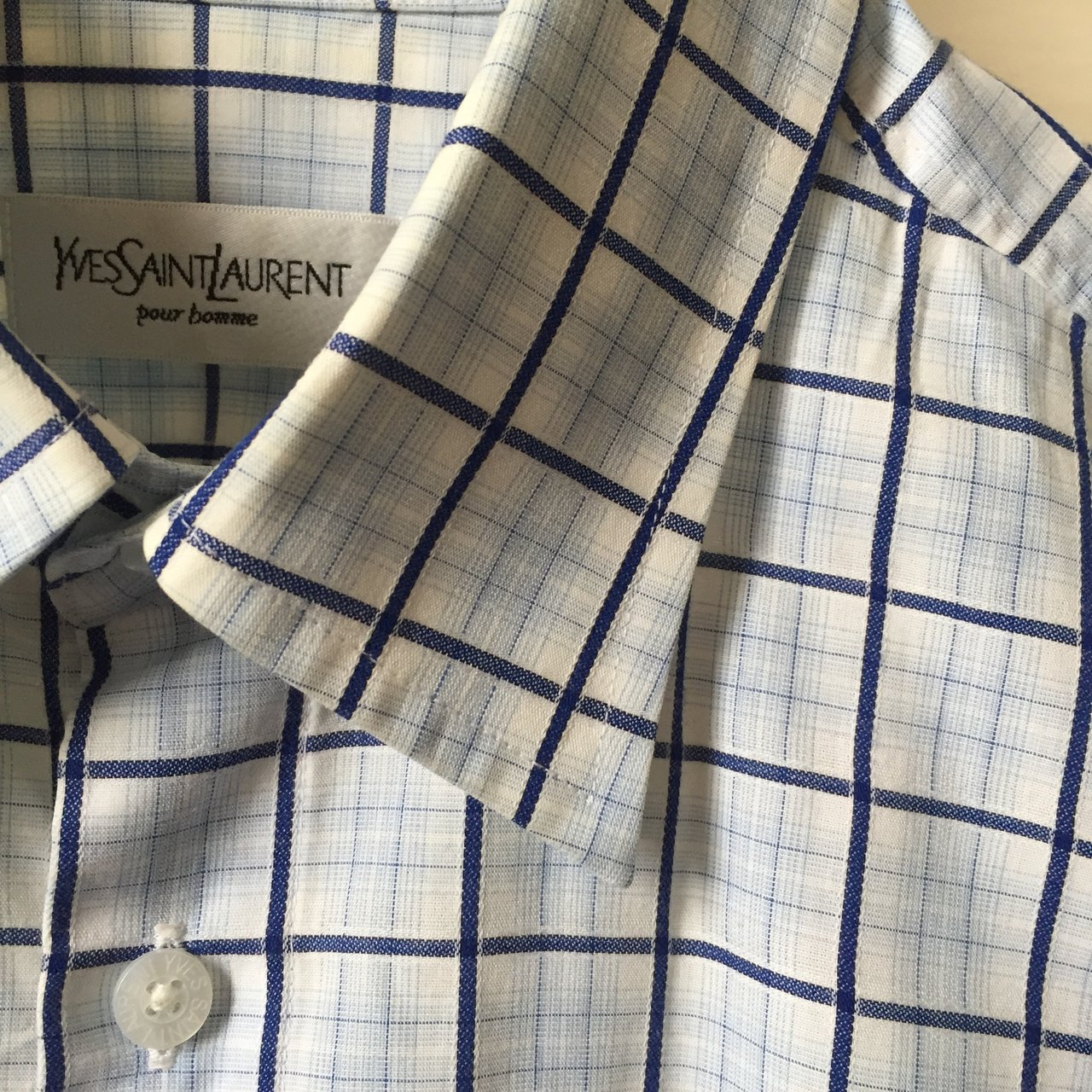 78719397cdc @sxskia. 11 months ago. Sheffield, United Kingdom. Vintage 90s white and  blue YSL Yves Saint Laurent short sleeve check shirt. Size: large ...