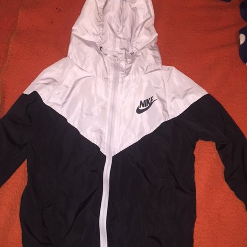 6e9fe06dd @taradaly13. last month. Shanagarry, Ireland. Black and white nike jacket👀  really lightweight perfect for wearing over hoodies