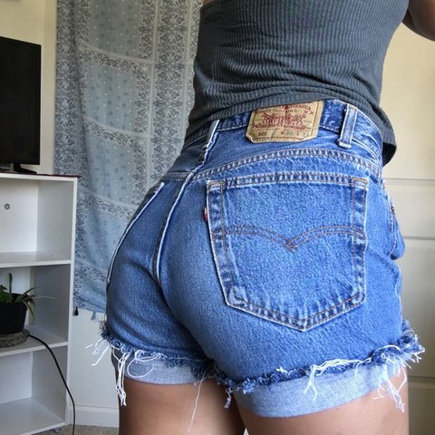 395cc7a9 @chicthrifty. 2 years ago. Chico, United States. VINTAGE LEVI 501 CUT OFF BUTTON  FLY FRAYED HIGH WAISTED SHORTS✨✨