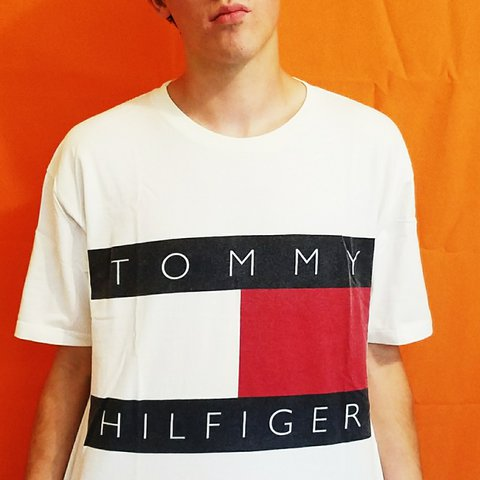 75239e36 @jedgar13. last year. Phoenix, Maricopa County, United States. Vintage 90s  Tommy Hilfiger tee with the classic large Tommy logo. Perfect condition.
