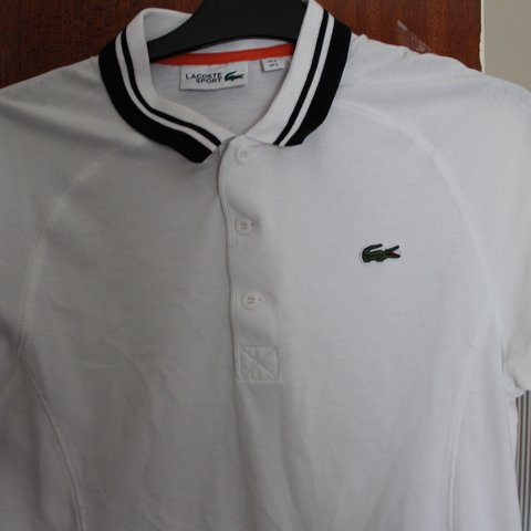 a83f3e96 White and black Lacoste polo amazing condition 9/10. It is a - Depop