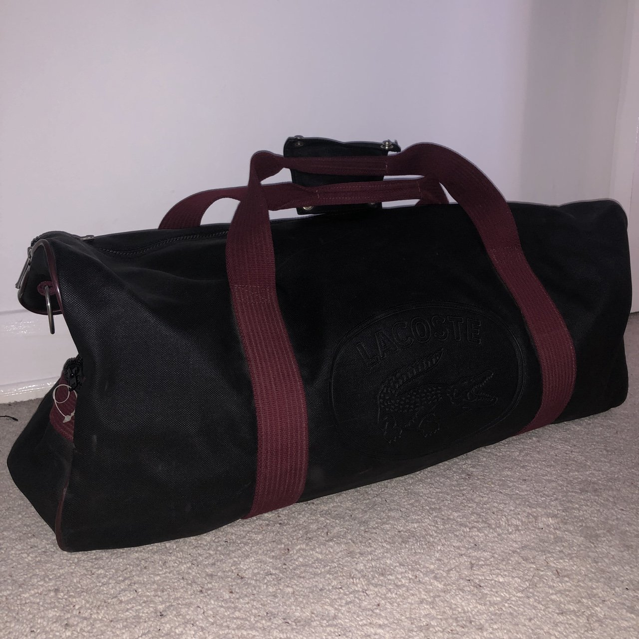 719b587eaa3 @chrispowell31. 5 months ago. Grimsby, United Kingdom. Vintage Lacoste  leather gym Keeptall hold-all bag