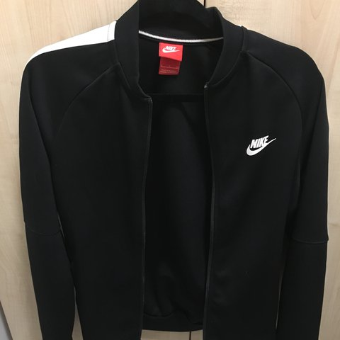 8868c18aab Nike black track top  tracksuit jacket. White stripe down a - Depop