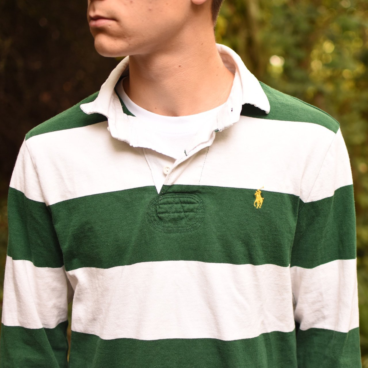 b3583981 @clemclothing. 2 years ago. Bedford, United Kingdom. Vintage green and  white striped Ralph Lauren rugby shirt.