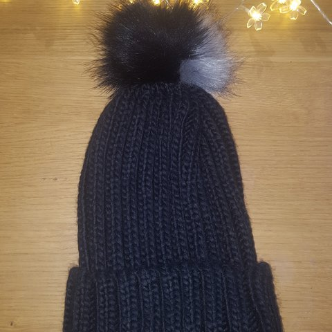 8bbd01bde74e9 Black knit bobble hat with grey and black fur bobble! Like - Depop