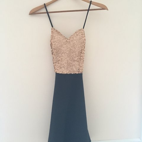 49b34cf495313 @thrifypanda. 5 months ago. United States. Beautiful black and gold dress  by Charlotte Russe!