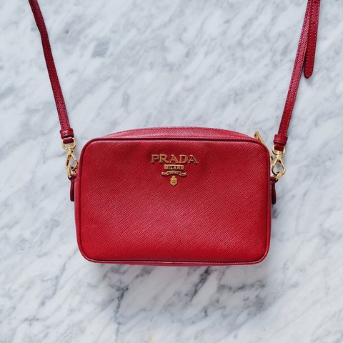 aef65c29cdd9 Prada Saffiano Cross Body Camera Bag in red. Used but in RRP - Depop