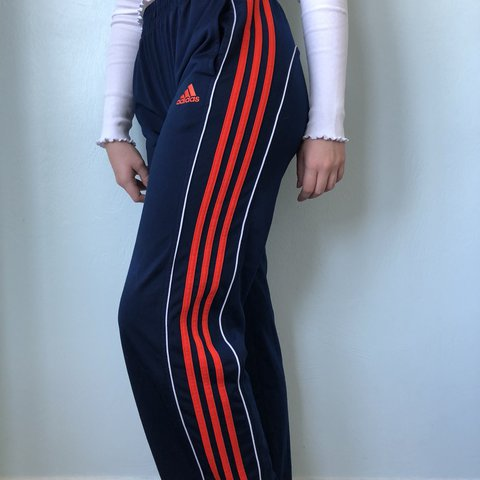 aafb57c7 @caitlinmackenna. last year. Utah, USA. Adidas track pants!! Navy with red/orange  stripes with white surrounding piping!
