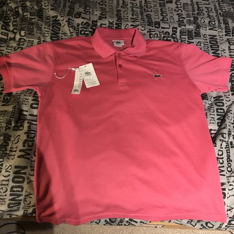 735ded35695d Men s pink Lacoste Polo T-Shirt for sale. No marks or stains - Depop