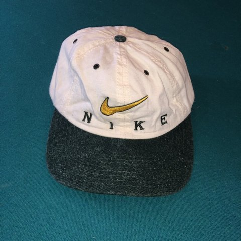29d267a7 @thriftedgear302. 5 months ago. Wilmington, United States. White and forest  green vintage Nike Hat in 8.5/10 Condition.