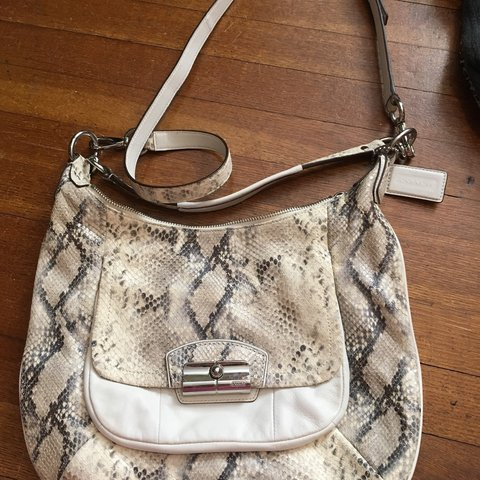 2262fcf20a @cfudge10. 11 months ago. Ames, United States. Coach purse. Leather. Brand  new worn once. Off white ...