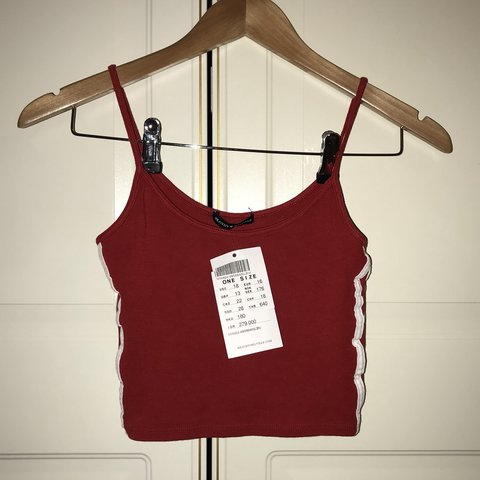 a22c06928ab brandy melville red vest top w white stripes down the side I - Depop