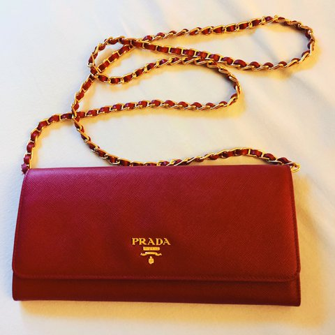 27fe6018ad0f ... official prada wallet on chain red fuoco saffiano leather gold depop  d1903 44260