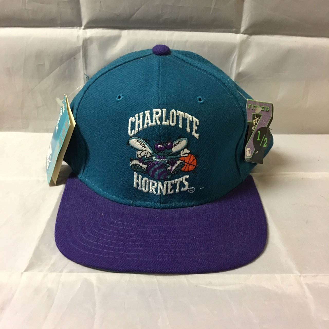 Vintage Charlotte Hornets fitted Starter hat from the 90 s. - Depop 07f7dabf82f