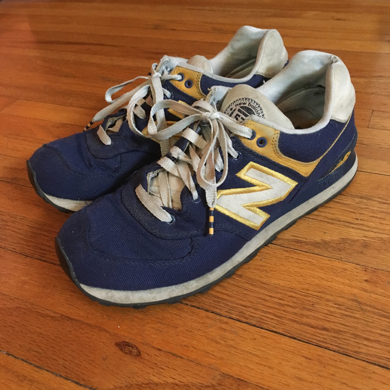 quality design 16a48 05316 Vintage New Balance 574 Classic navy and gold color... - Depop