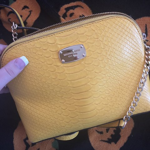 5b150c838d53 @madisynxanne. 3 days ago. United States. Michael Kors Yellow Purse  Adjustable strap, really cute