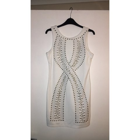7d9a6fdf1a1  sophiemissetx. 8 months ago. United Kingdom. White bodycon dress with gold  studs. UK size 12