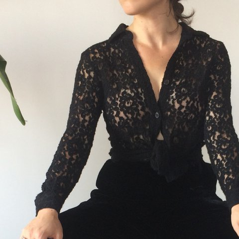 49ef6866 @shop_romie. 2 years ago. Los Angeles, United States. Vintage semi-sheer  black lace button down shirt.